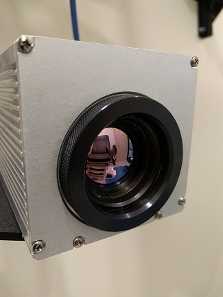 medical chair reflecting in the lens of a camera