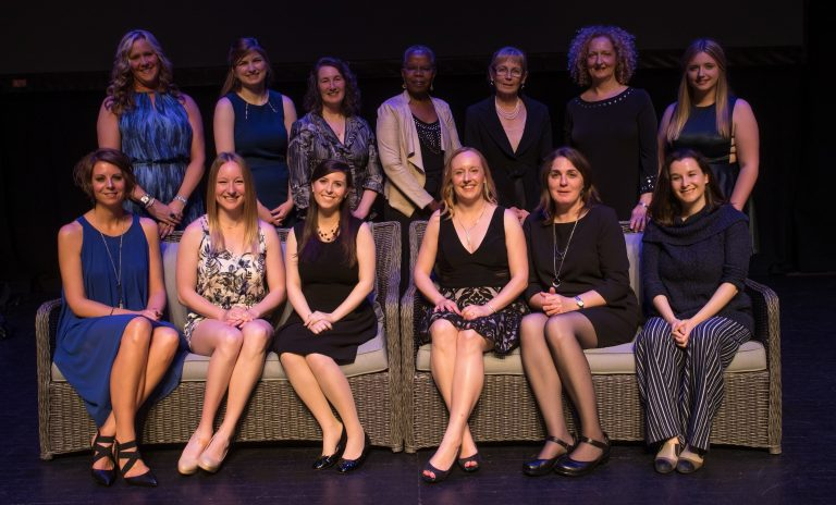 Photo of 13 women honoured at the Women of Distinction Awards