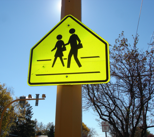 School crossing street sign in yellow
