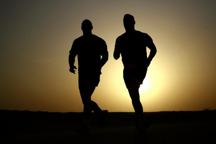Two men are out running in the early morning